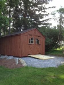 Slideshow Image - Board and Batten on Gravel Base with optional Cedar Stain, Strap Hinges and Carriage Style doors.